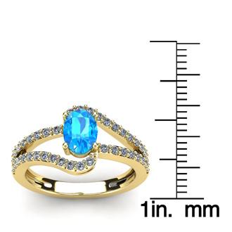 1 1/2 Carat Oval Shape Blue Topaz and Fancy Diamond Ring In 14 Karat Yellow Gold