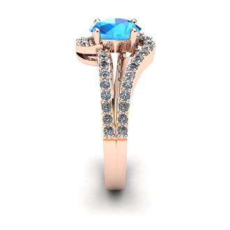 1 1/2 Carat Oval Shape Blue Topaz and Fancy Diamond Ring In 14 Karat Rose Gold
