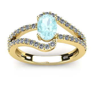 1 1/4 Carat Oval Shape Aquamarine and Fancy Diamond Ring In 14 Karat Yellow Gold