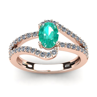 1 1/4 Carat Oval Shape Emerald and Fancy Diamond Ring In 14 Karat Rose Gold