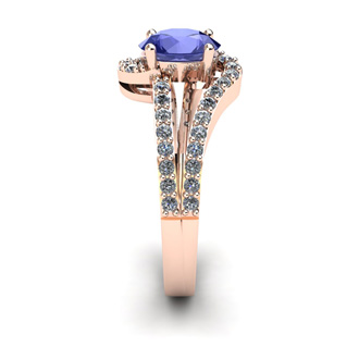 1 1/3 Carat Oval Shape Tanzanite and Fancy Diamond Ring In 14 Karat Rose Gold