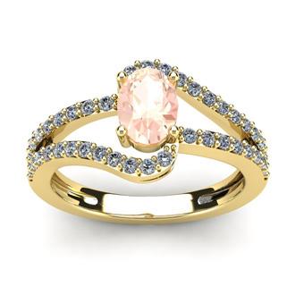 1 1/4 Carat Oval Shape Morganite and Fancy Diamond Ring In 14 Karat Yellow Gold