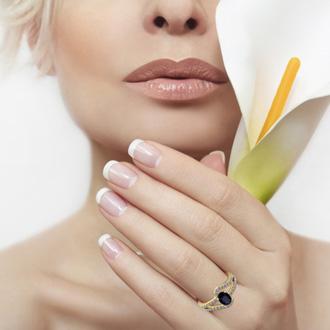 1 1/2 Carat Oval Shape Sapphire and Fancy Diamond Ring In 14 Karat Yellow Gold