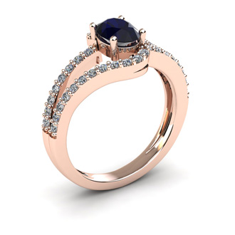 1 1/2 Carat Oval Shape Sapphire and Fancy Diamond Ring In 14 Karat Rose Gold