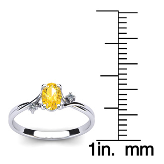 1/2 Carat Oval Shape Citrine and Two Diamond Accent Ring In 14 Karat White Gold