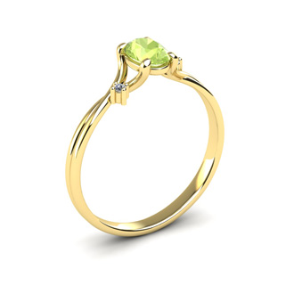 1/2 Carat Oval Shape Peridot and Two Diamond Accent Ring In 14 Karat Yellow Gold