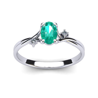 1/2 Carat Oval Shape Emerald and Two Diamond Accent Ring In 14 Karat White Gold