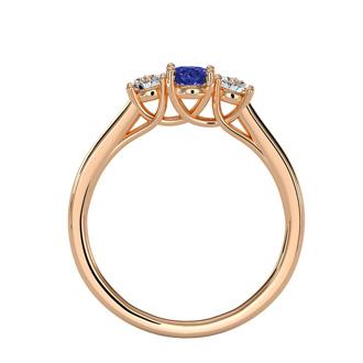 3/4 Carat Oval Shape Tanzanite and Two Diamond Ring In 14 Karat Rose Gold