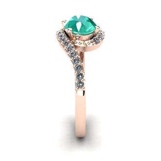 1 1/2 Carat Oval Shape Emerald and Halo Diamond Ring In 14 Karat Rose Gold