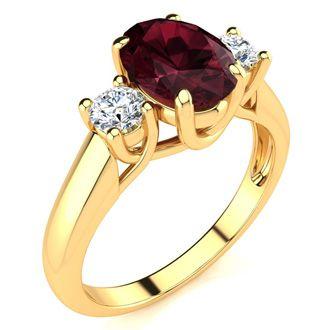 1 3/4 Carat Oval Shape Garnet and Two Diamond Ring In 14 Karat Yellow Gold