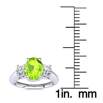 1 Carat Oval Shape Peridot and Two Diamond Ring In 14 Karat White Gold