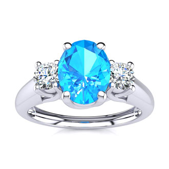 1 1/5 Carat Oval Shape Blue Topaz and Two Diamond Ring In 14 Karat White Gold