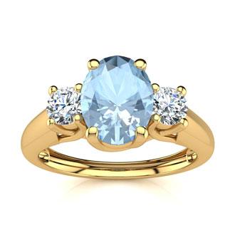 1 Carat Oval Shape Aquamarine and Two Diamond Ring In 14 Karat Yellow Gold