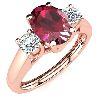 1.15 Carat Oval Shape Ruby and Two Diamond Ring In 14 Karat Rose Gold