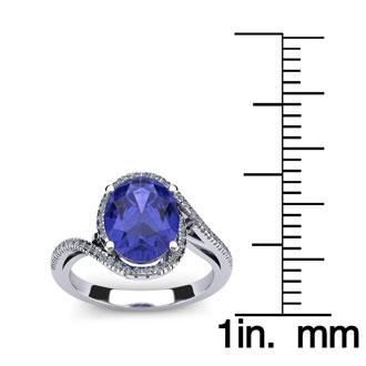 1 1/2 Carat Oval Shape Tanzanite and Halo Diamond Ring In 14 Karat White Gold