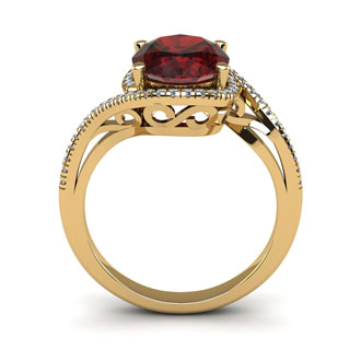1 3/4 Carat Oval Shape Garnet and Halo Diamond Ring In 14 Karat Yellow Gold
