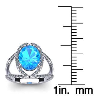 2 Carat Oval Shape Blue Topaz and Halo Diamond Ring In 14 Karat White Gold