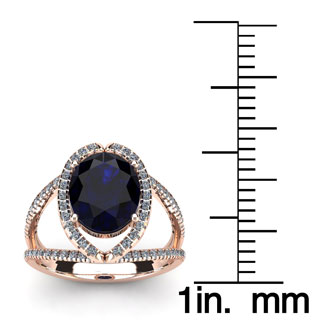 2 Carat Oval Shape Sapphire and Halo Diamond Ring In 14 Karat Rose Gold