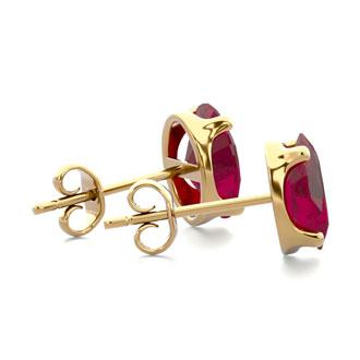 2 Carat Oval Shape Ruby Stud Earrings In 14K Yellow Gold Over Sterling Silver