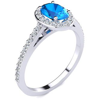 1 1/3 Carat Oval Shape Blue Topaz and Halo Diamond Ring In 14 Karat White Gold
