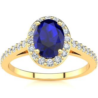 1 1/3 Carat Oval Shape Sapphire and Halo Diamond Ring In 14 Karat Yellow Gold