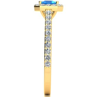 1 1/2 Carat Emerald Shape Blue Topaz and Halo Diamond Ring In 14 Karat Yellow Gold