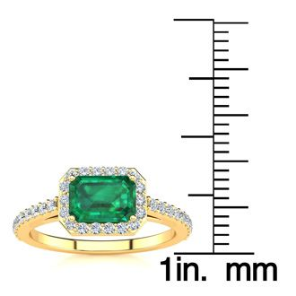 1 1/4 Carat Emerald Shape Emerald and Halo Diamond Ring In 14 Karat Yellow Gold