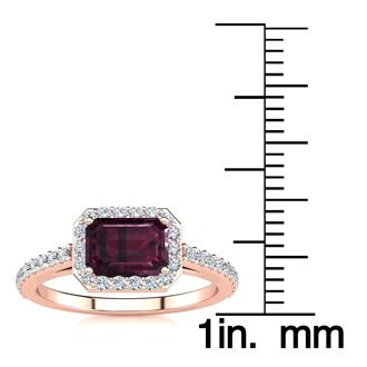 1 1/2 Carat Emerald Shape Garnet and Halo Diamond Ring In 14 Karat Rose Gold
