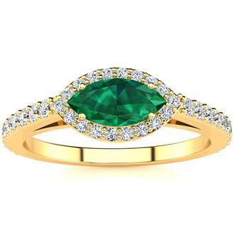 3/4 Carat Marquise Shape Emerald and Halo Diamond Ring In 14 Karat Yellow Gold