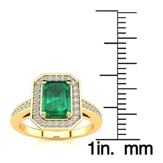 1 Carat Emerald Shape Emerald and Halo Diamond Ring In 14 Karat Yellow Gold