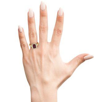 1 1/2 Carat Emerald Shape Garnet and Halo Diamond Ring In 14 Karat Yellow Gold