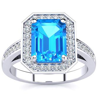 2 1/4 Carat Emerald Shape Blue Topaz and Halo Diamond Ring In 14 Karat White Gold