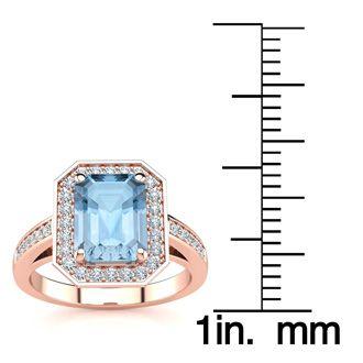 1 3/4 Carat Emerald Shape Aquamarine and Halo Diamond Ring In 14 Karat Rose Gold