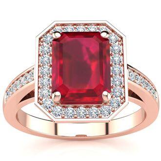 2 1/2 Carat Emerald Shape Ruby and Halo Diamond Ring In 14 Karat Rose Gold