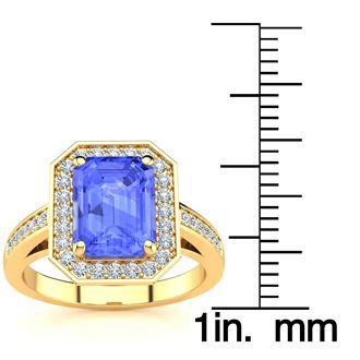 3 Carat Emerald Shape Tanzanite and Halo Diamond Ring In 14 Karat Yellow Gold