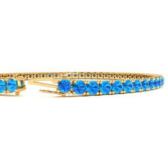 9 Inch 6 3/4 Carat Blue Topaz Tennis Bracelet In 14K Yellow Gold
