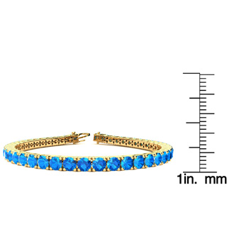 8.5 Inch 14 Carat Blue Topaz Tennis Bracelet In 14K Yellow Gold