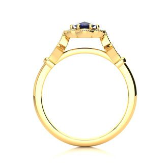 1 Carat Oval Shape Sapphire and Halo Diamond Vintage Ring In 14 Karat Yellow Gold
