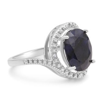 5 1/2 Carat Sapphire and Halo Diamond Ring In Sterling Silver.