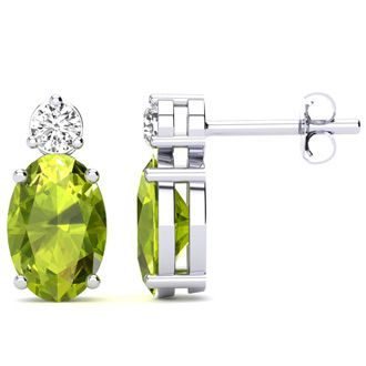 1 3/4 Carat Oval Peridot and Diamond Stud Earrings In 14 Karat White Gold