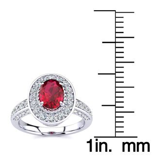 1 1/2 Carat Oval Shape Ruby and Halo Diamond Ring In 14 Karat White Gold