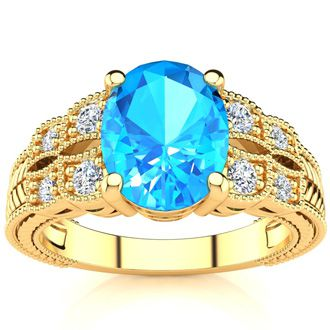 2 1/3 Carat Oval Shape Blue Topaz and Diamond Ring In 10 Karat Yellow Gold