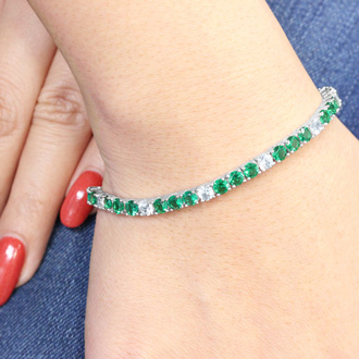 10 1/2 Carat Created Emerald and Diamond White Sapphire Tennis Bracelet In Sterling Silver, 7 Inches