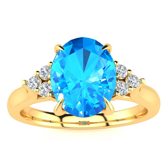 2 1/4 Carat Oval Shape Blue Topaz and Diamond Ring In 14K Yellow Gold