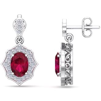 2 1/5 Carat Oval Shape Ruby and Diamond Dangle Earrings In 14 Karat White Gold
