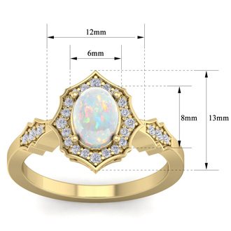 1 1/4 Carat Oval Shape Opal and Diamond Ring In 14 Karat Yellow Gold