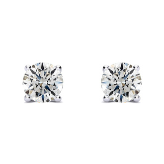 1 Carat Round Diamond Stud Earrings In Platinum