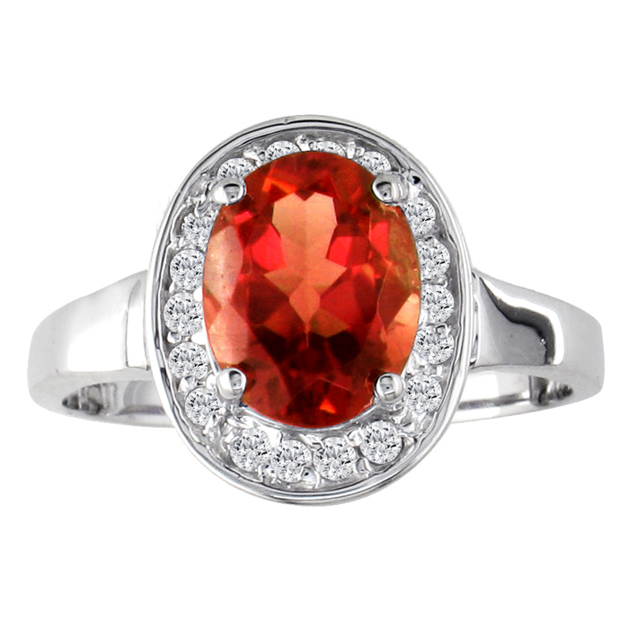 1 1/2ct Oval Cut Garnet and .18ct Diamond Ring in 14k White Gold