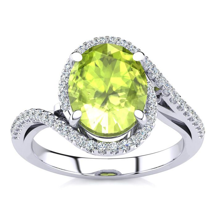 2 3/4 Carat Oval Shape Peridot and Halo Diamond Ring In 14 Karat White Gold