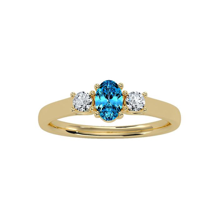 3/4 Carat Oval Shape Blue Topaz & Two Diamond Ring in 14K Yellow